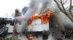 Firefighters battle an inferno at a home on
