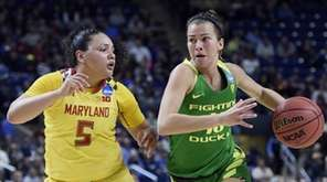 Oregon's Lexi Bando, right, dribbles as Maryland's Destiny