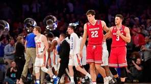 Ethan Happ #22 and Zak Showalter #3 of