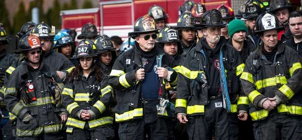 Firefighters from across Nassau County gather during a