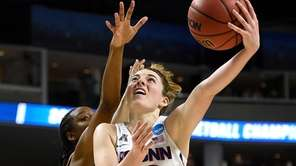 Connecticut's Katie Lou Samuelson shoots as UCLA's Kennedy
