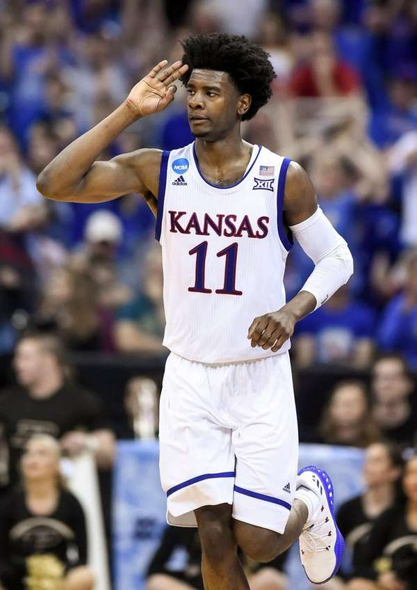 Kansas guard Josh Jackson (11) signals three for