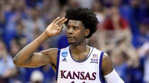 Kansas guard Josh Jackson (11) signals three for