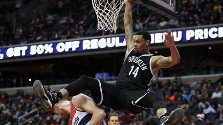 KJ McDaniels, #14, of the Brooklyn Nets collides