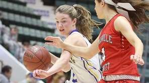 Kellenberg's Alyssa Boll, left, drives against Jamesville-Dewitt in