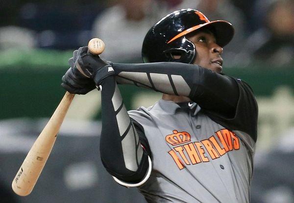 Netherlands' designated hitter Didi Gregorius hits a three-run