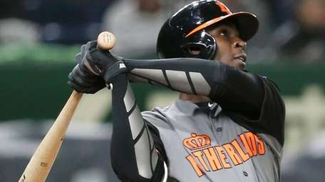 Netherlands' designated hitter Didi Gregorius hits a three-run