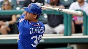 New York Mets' Michael Conforto hits a home
