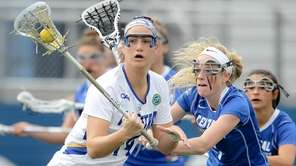 Hofstra's Becky Conto (14) carries the ball while