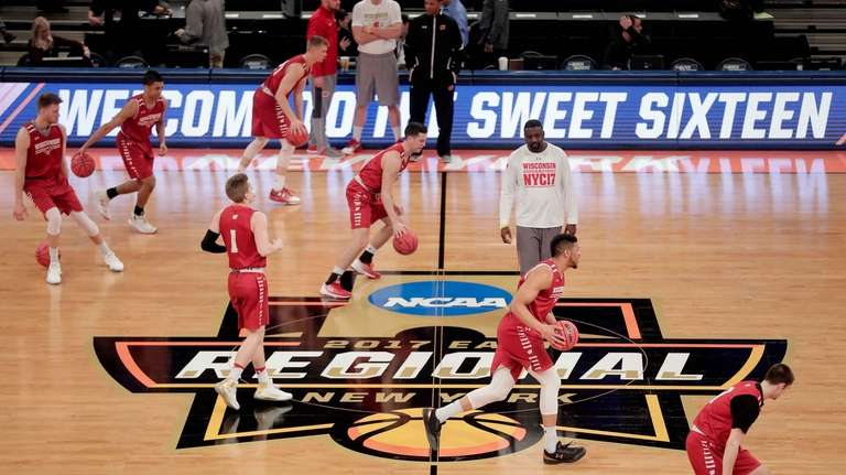 Wisconsin players dribble across the court during practice,