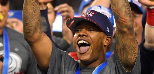 U.S. pitcher Marcus Stroman celebrates with the MVP