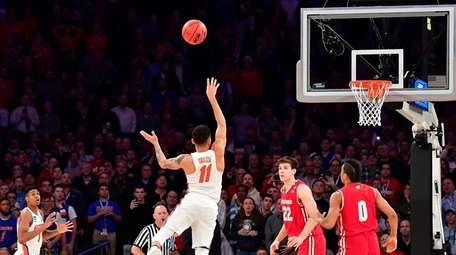 Florida's Chris Chiozza lets the winning three-pointer fly
