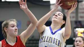 Kellenberg's Clare Calabro, center, goes for a layup