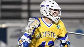 Hofstra attacker Ryan Tierney controls the ball behind