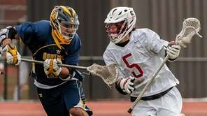 Syosset's David Moyet (5) drives around Northport's Brandon