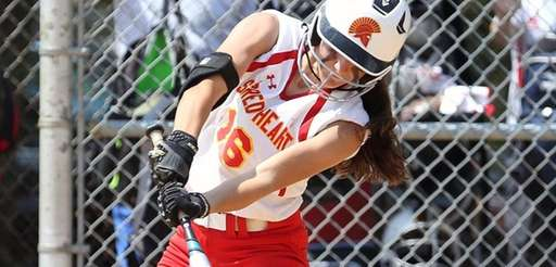 Base hit by Sacred Heart's Marissa Braito during