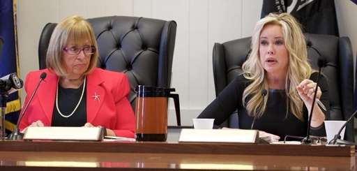 Islip Supervisor Angie Carpenter, left, watches as Councilwoman