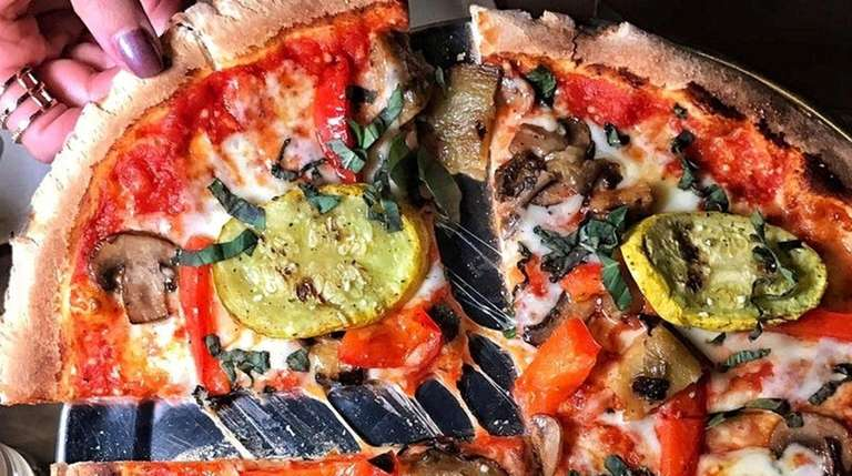 Pizzettes are among the menu items at Locale