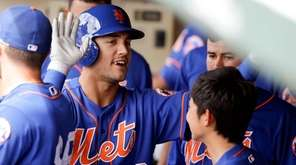 New York Mets' Michael Conforto (30) high-fives teammates