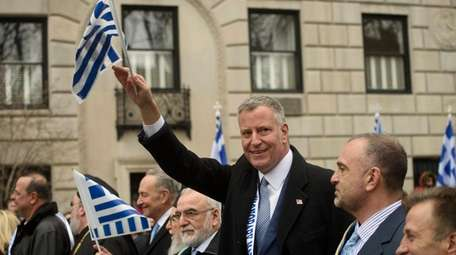New York City Mayor Bill de Blasio marches