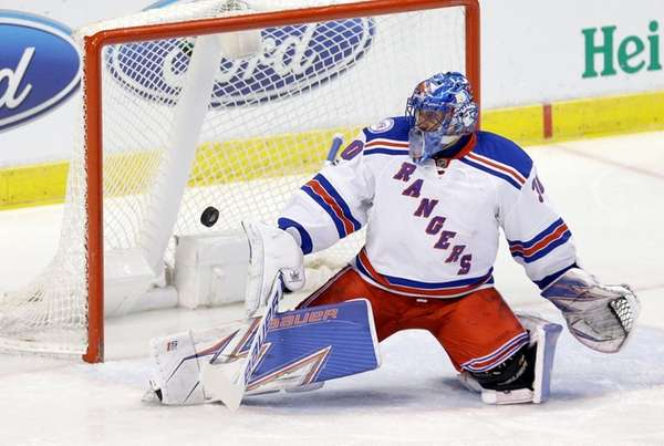 New York Rangers goalie Henrik Lundqvist (30) deflects