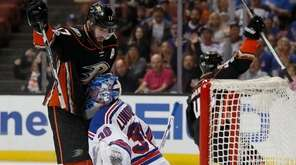 Anaheim Ducks center Ryan Kesler, left, runs into