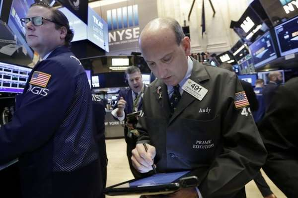 Trader Andrew Silverman works on the floor of