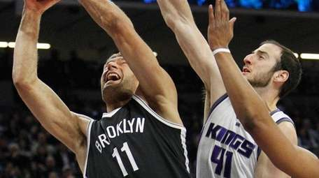 Brooklyn Nets center Brook Lopez drives to the