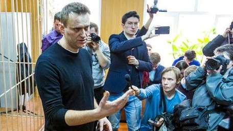 Russian opposition leader Alexei Navalny, foreground, speaks to