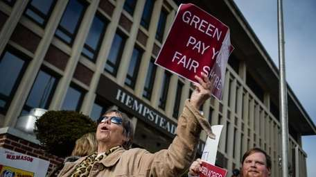 Joanne O'Leary, of Valley Stream, holds a sign
