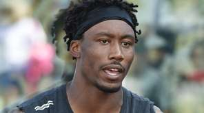 Brandon Marshall speaks with a reporter during