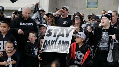 Oakland Raiders fans gather for a picture before