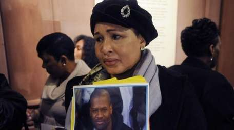 Hawa Bah, mother of Mohamed Bah, holds a
