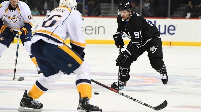 New York Islanders center John Tavares skates with