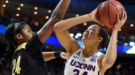 Connecticut's Napheesa Collier, right, shoots as Oregon's Ruthy