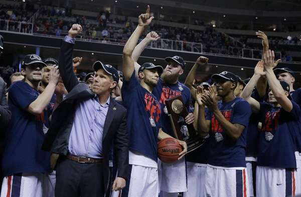 Gonzaga players and coach Mark Few, second from