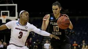 Florida State guard Leticia Romero, right, drives against