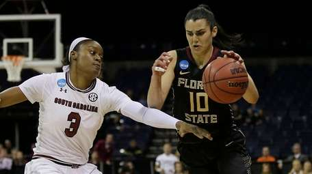 Florida State guard Leticia Romero, right, drives against