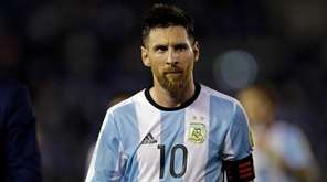 Argentina?s Lionel Messi leaves the pitch after a