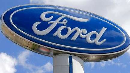 A Ford sign at an auto dealership in