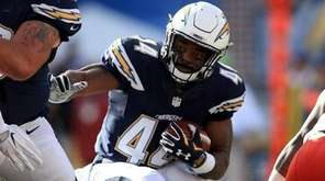 Andre Williams of the San Diego Chargers runs