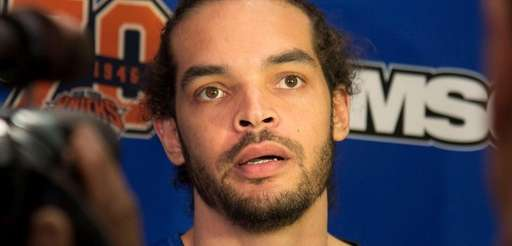 New York Knicks' Joakim Noah speaks with the