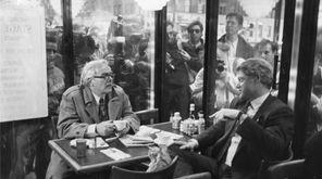 Newsday columnist Jimmy Breslin talks with Gov. Bill