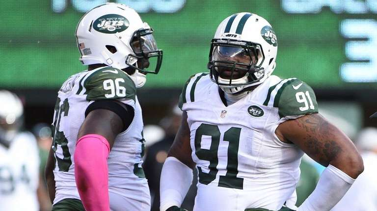 Jets defensive end Muhammad Wilkerson, left, and