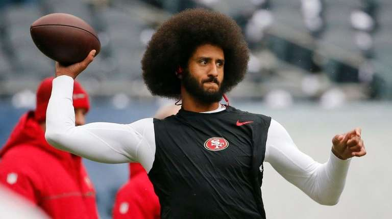 San Francisco 49ers quarterback Colin Kaepernick warms up
