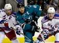 San Jose Sharks' Joe Pavelski (8) is defended