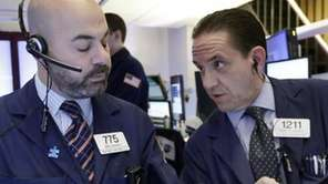 Traders Fred Demarco, left, and Tommy Kalikas work