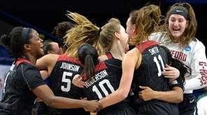 Members of the Stanford women's team celebrate after