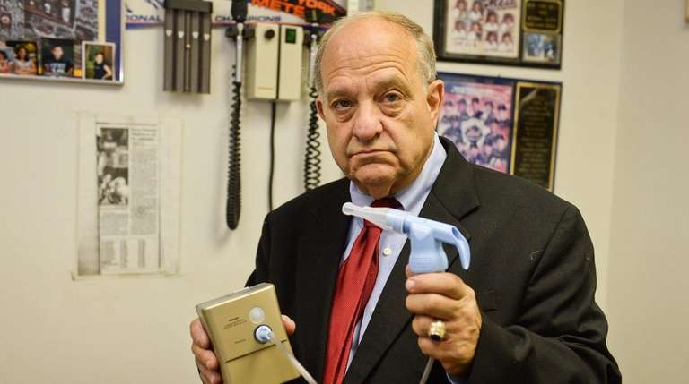 Asthma specialist Dr. Harvey Miller stands with a