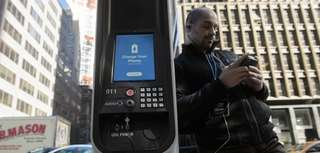 Washington Heights resident Anthony Ramos charges his mobile